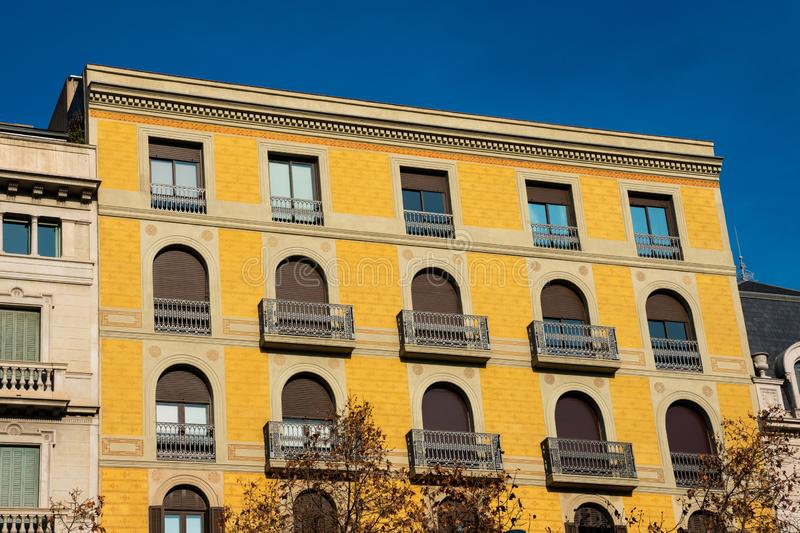 Old building facade and balconies on Passeig de Gracia Avenue. Barcelona, Spain. February 9, 2019. Old building facade and balconies on Passeig de Gracia Avenue stock photography