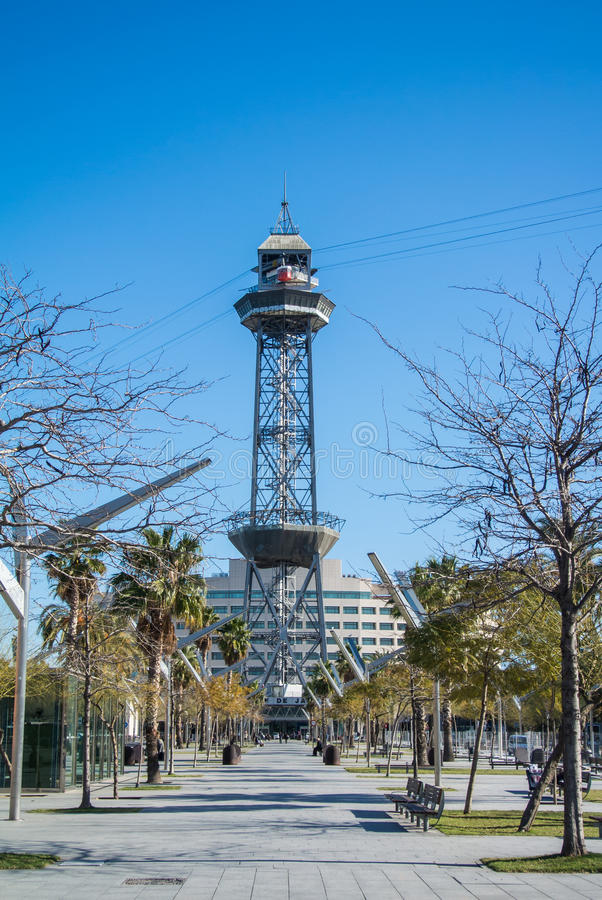 BARCELONA, SPAIN - FEBRUARY 12, 2014: A park in Barcelona and a cable car station on the background. Spain stock photo