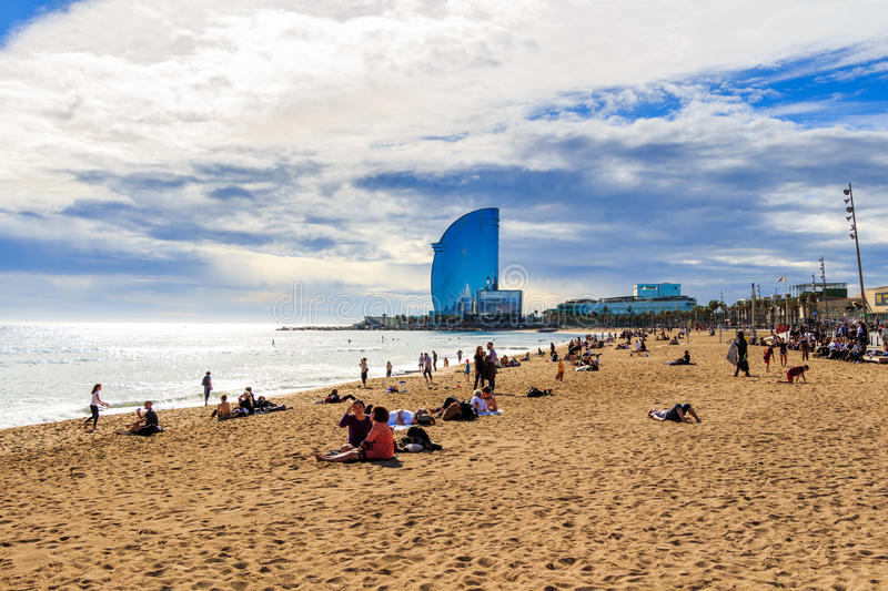 BARCELONA, SPAIN - February 13, 2016: View of Barceloneta Beach in Barcelona, Spain. It is one of the most popular beach in Europe.  stock photos