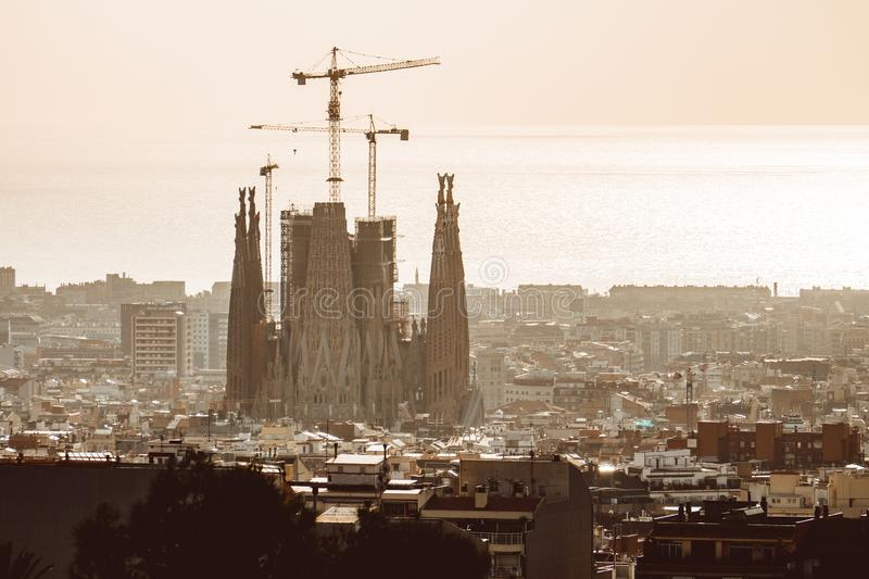 View of Barcelona on a cloudy day with a layer of air pollution. Photo taken from Park Guell: cityscape, skyline. BARCELONA, SPAIN - February 2019: View of stock photography