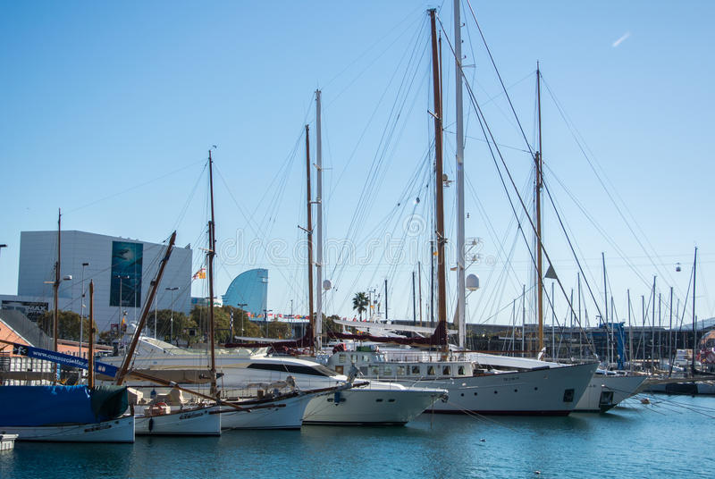 BARCELONA, SPAIN - FEBRUARY 12, 2014: A view to a pier with yachts at Barcelona port. Catalonia, Spain stock images