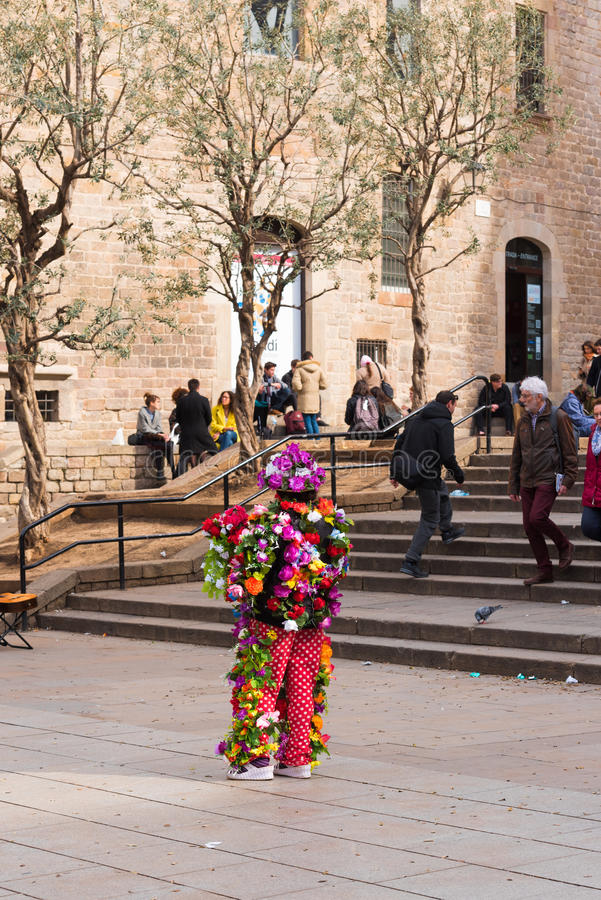 BARCELONA, SPAIN - FEBRUARY 16, 2017: A woman in flowers near the Cathedral of the Holy Cross and St. Eulalia. Copy space. BARCELONA, SPAIN - FEBRUARY 16, 2017 royalty free stock photos