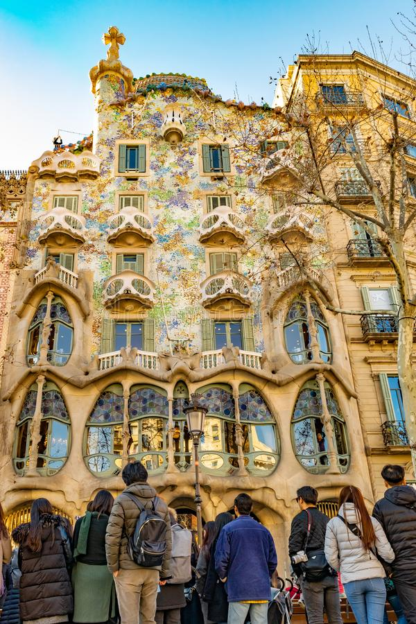 Gaudi Batllo House Building, Barcelona, Spain. BARCELONA, SPAIN, JANUARY - 2018 - Crowded watching batllo house, a famous gaudi masterpiece atchitecture located royalty free stock photos