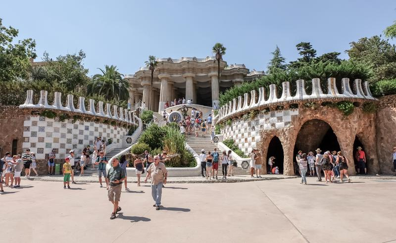 Park Guell, Barcelona. BARCELONA, SPAIN - JUL 19, 2018: Walking people in Park Guell. The Park Guell is a public park system composed of gardens and stock photos
