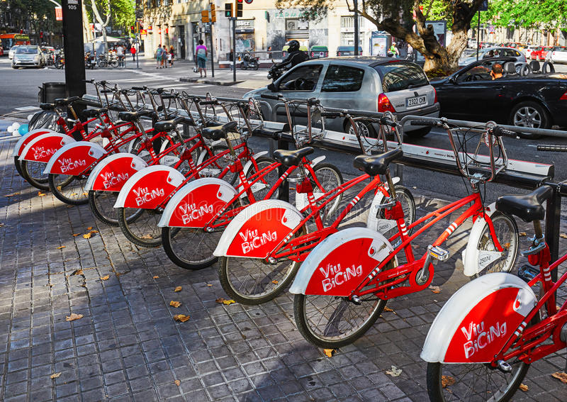 Barcelona, Spain- July 3, 2016: Bicycle - public transport in Barcelona. Barcelona, Spain- July 3, 2016: Red bicycle - public transport in Barcelona royalty free stock image
