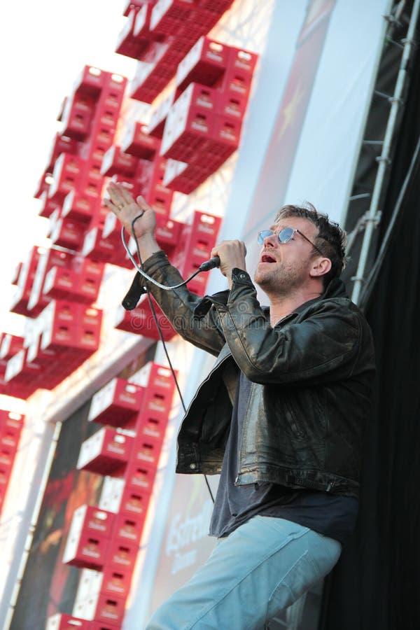 BARCELONA, SPAIN - JULY 11, 2014: Damon Albarn, singer from Blur, performing live. BARCELONA, SPAIN - JULY 11, 2014: Damon Albarn, singer from Blur and Gorillaz royalty free stock image