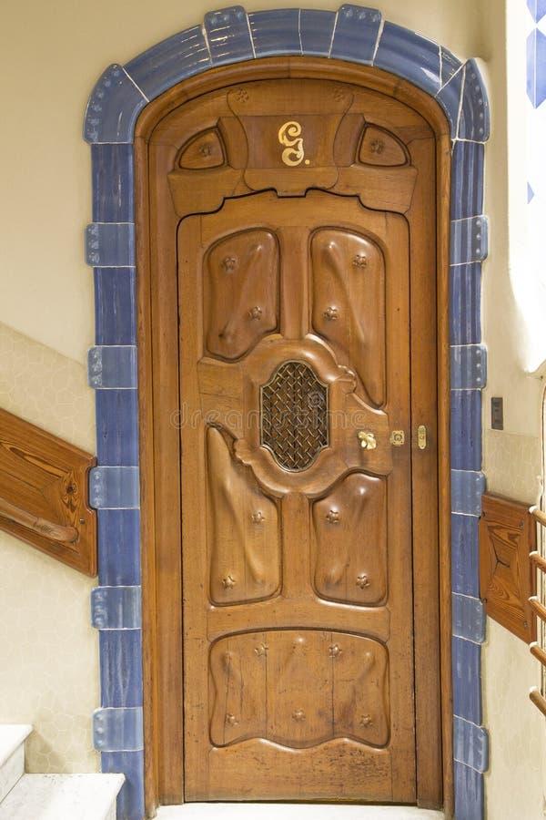 Decorative door in Casa Batllo. Decorative wooden door in Casa Batllo in Barcelona, Spain. The architectural masterpiece of Antonio Gaudi royalty free stock photo