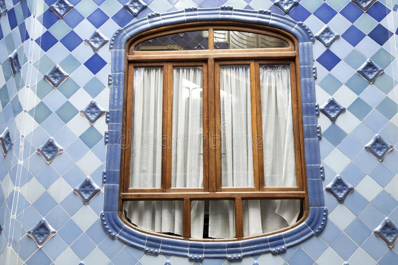 Decorative window on Casa Batllo. Detail of the inner facade of Casa Batllo in Barcelona, Spain. The architectural masterpiece of Antonio Gaudi stock photo