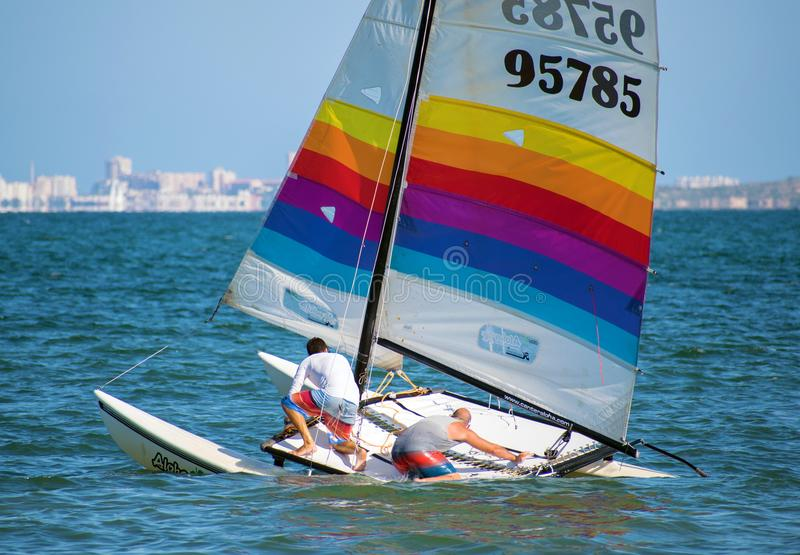 Barcelona, Spain, July 23, 2019: Group of people sailing in Spain. Barcelona, Spain, July 23, 2019: Group of people taking a initiation class of sailing in Spain royalty free stock photography
