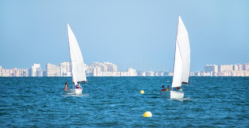 Barcelona, Spain, July 23, 2019: Group of people sailing in Spain. Barcelona, Spain, July 23, 2019: Group of people taking a initiation class of sailing in Spain stock photo