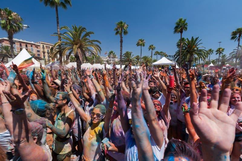 BARCELONA, SPAIN - JULY 9, 2016: Holi festival. BARCELONA, SPAIN - JULY 9, 2016: Crowd holding hands in air at Holi festival at Escenario del Moll de la Fusta royalty free stock image