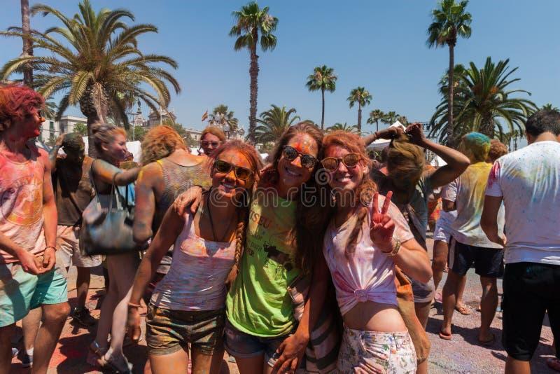 BARCELONA, SPAIN - JULY 9, 2016: Holi festival. At Escenario del Moll de la Fusta. Girls in painted dresses make smile stock images