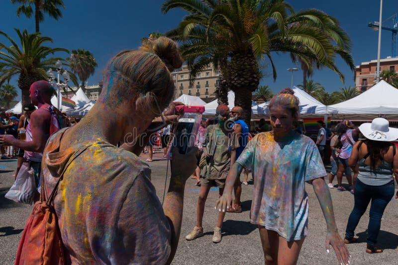 BARCELONA, SPAIN - JULY 9, 2014: Holi festival. At Escenario del Moll de la Fusta. Visitors make photos stock images