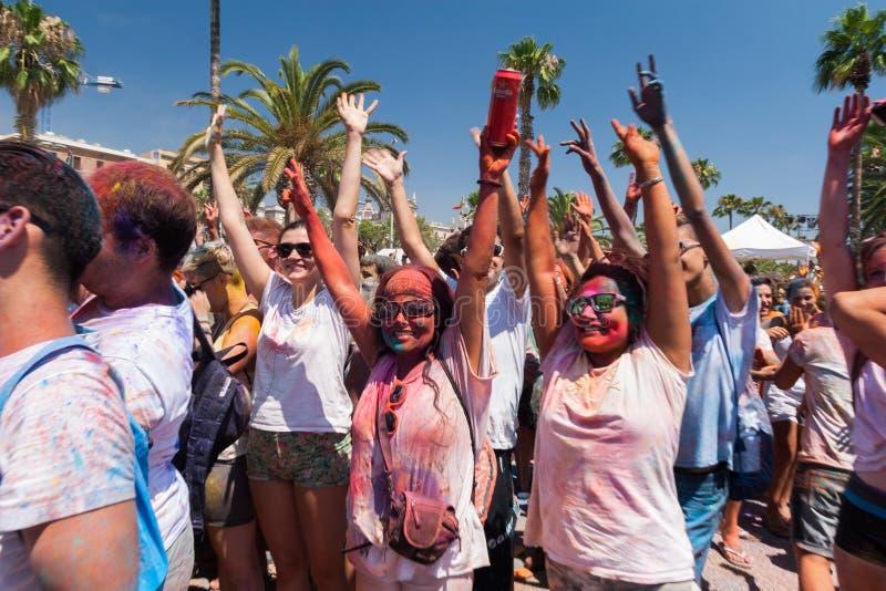 BARCELONA, SPAIN - JULY 9, 2014: Holi festival. BARCELONA, SPAIN - JULY 9, 2014: Visitors of Holi festival at Escenario del Moll de la Fusta. People put hands up royalty free stock images