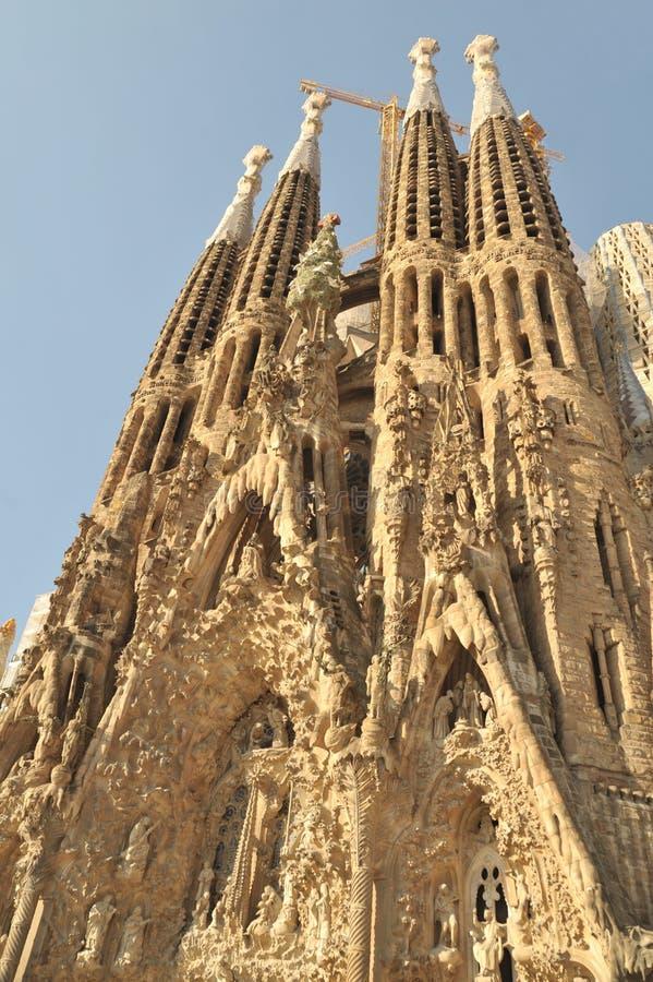 Barcelona, Spain - July 20, 2018 La Sagrada Familia, iconic landmark cathedral designed by Antoni Gaudi,  build since 1882, bell t. Owers stock photography