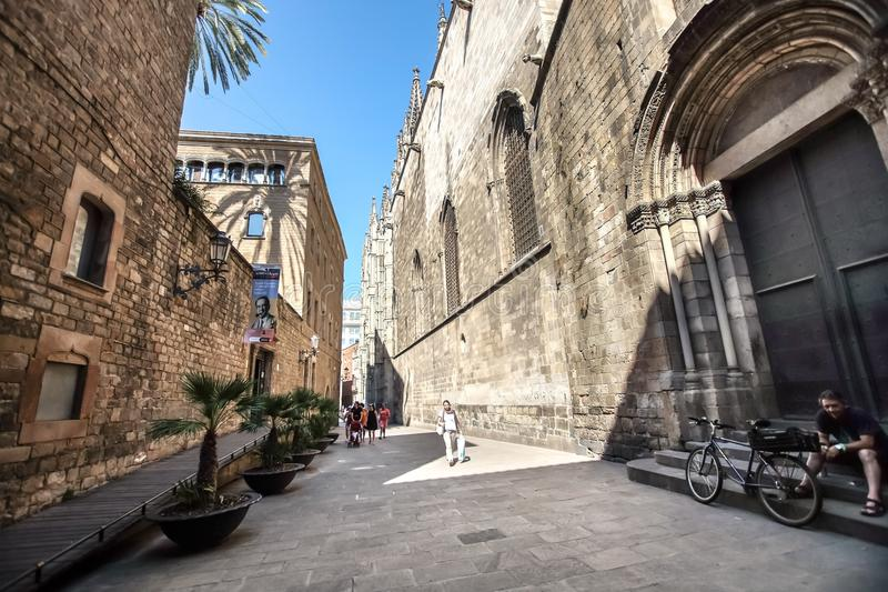 Gothic Quarter, Barcelona. BARCELONA, SPAIN - JULY 17, 2018: Narrow streets of the Gothic Quarter. The quarter encompasses the oldest parts of the city of stock image
