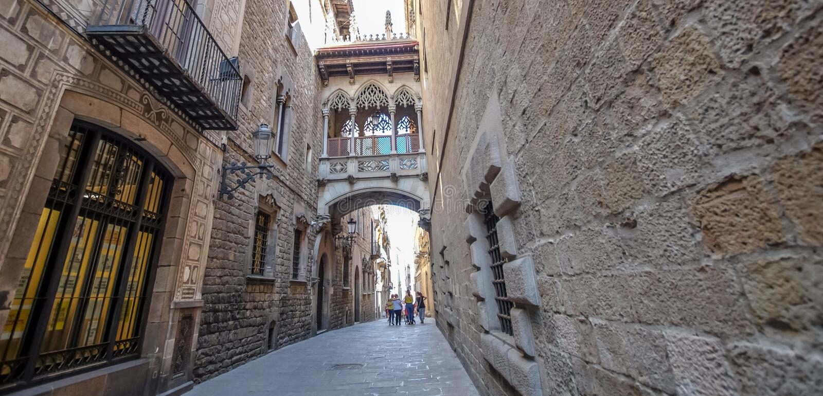 Gothic Quarter, Barcelona. BARCELONA, SPAIN - JULY 17, 2018: Narrow streets of the Gothic Quarter. The quarter encompasses the oldest parts of the city of stock photography
