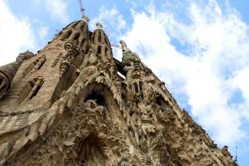 Architecture in Barcelona, Spain. Barcelona, Spain - July 6, 2018: Nativity facade of Sagrada Familia - famous cathedral in Barcelona, Spain designed by Antoni royalty free stock photos
