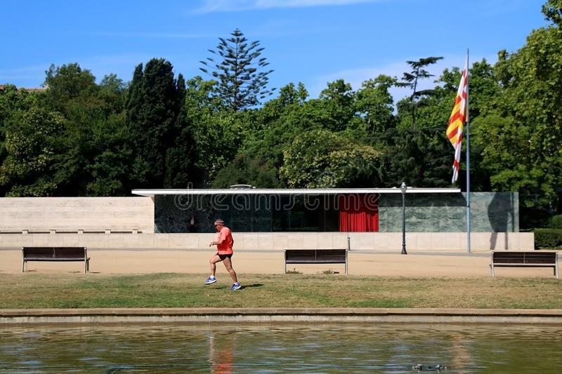 Architecture in Barcelona, Spain. Barcelona, Spain - July 8, 2018: Barcelona Pavilion, designed by Ludwig Mies van der Rohe in Barcelona, Spain. Senior man royalty free stock images