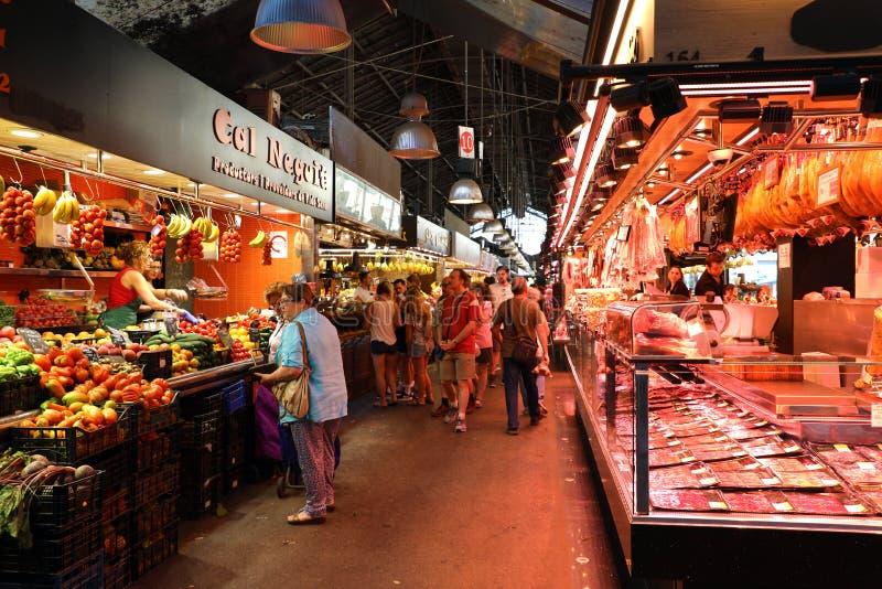 BARCELONA, SPAIN - JULY 13, 2018: people shop in Barcelona Market Mercat de Sant Josep de la Boqueria, a large public market. With entrance near La Rambla royalty free stock image