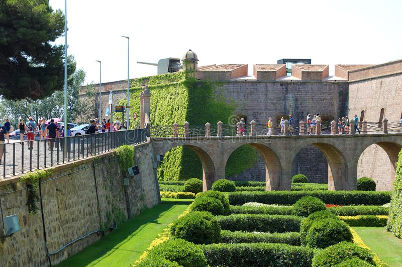 BARCELONA, SPAIN - JULY 12, 2018: people visiting Montjuic Castle; it is an old military fortress. With roots dating back from 1640, built on top of Montjuï royalty free stock photos