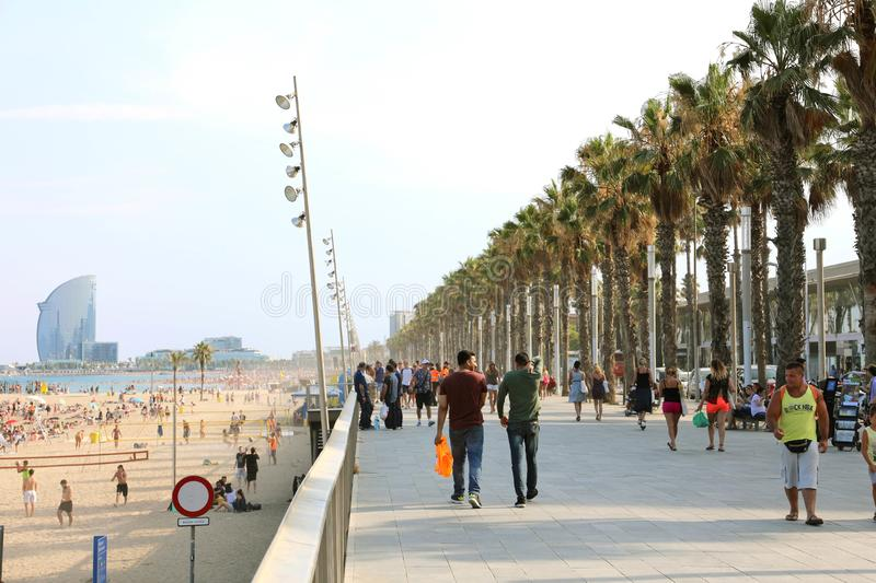 BARCELONA, SPAIN - JULY 11, 2018: promenade of Barceloneta beach. With people enjoying sunny day in Barcelona and W hotel on background, Catalonia, Spain stock photos