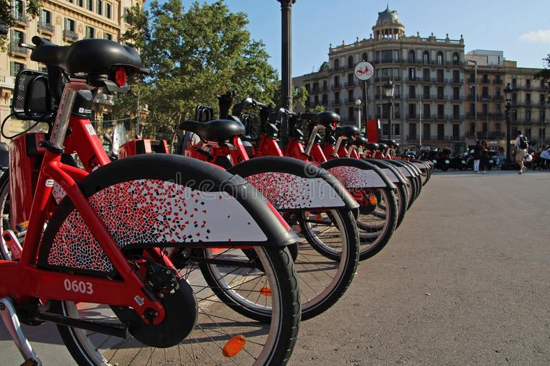 Red bikes for rent in Barcelona. Barcelona, Spain - July 14, 2019: Red bikes for rent in Barcelona royalty free stock photos