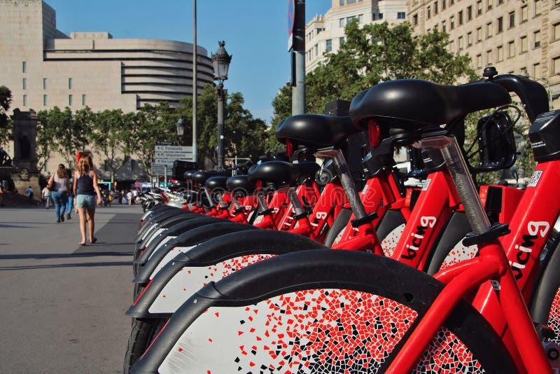 Red bikes for rent in Barcelona. Barcelona, Spain - July 14, 2019: Red bikes for rent in Barcelona stock photos