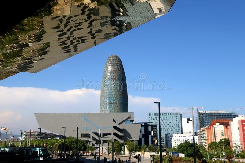 Architecture in Barcelona, Spain. Barcelona, Spain - July 7, 2018: Reflective roof of Mercat dels Encants flea market, The Disseny Hub Barcelona museum and the stock images