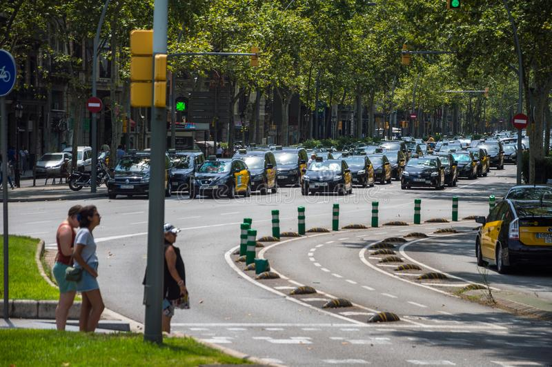 Barcelona, Spain; July 29 2018: Strike of taxi drivers against Uber and Cabify. A large number of Taxi blocking the street of Gran Via de les Cortes Catalanes in stock photography