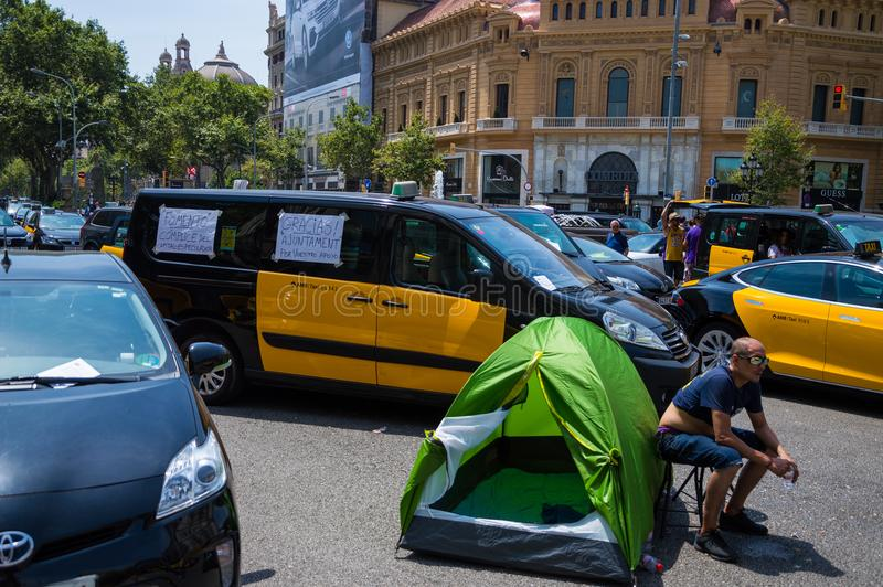 Barcelona, Spain; July 29 2018: Strike of taxi drivers against Uber and Cabify. A large number of Taxi blocking the street of Gran Via de les Cortes Catalanes in stock photo