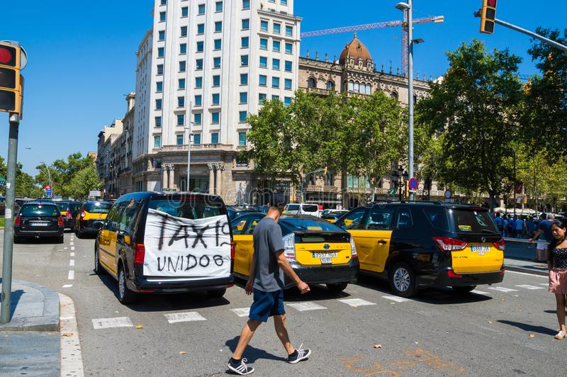 Barcelona, Spain; July 29 2018: Strike of taxi drivers against Uber and Cabify. A large number of Taxi blocking the street of Gran Via de les Cortes Catalanes in royalty free stock images