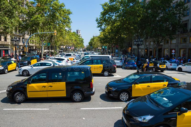 Barcelona, Spain; July 29 2018: Strike of taxi drivers against Uber and Cabify. A large number of Taxi blocking the street of Gran Via de les Cortes Catalanes in royalty free stock photos