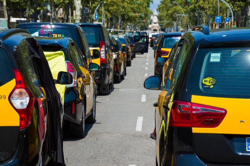 Barcelona, Spain; July 29 2018: Strike of taxi drivers against Uber and Cabify. A large number of Taxi blocking the street of Gran Via de les Cortes Catalanes in stock photos