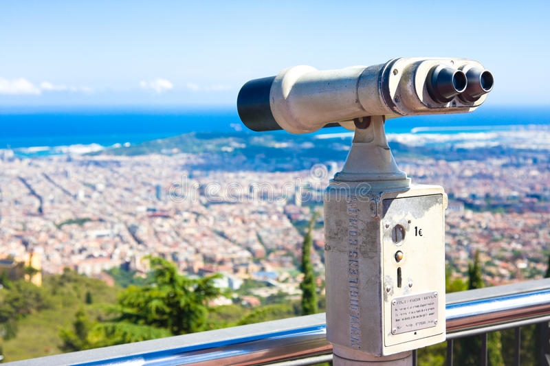 BARCELONA, SPAIN - JULY 13, 2016:Touristic telescope look at Barcelona, close up metal binoculars on background viewpoint overlook. Ing mountain, hipster coin royalty free stock photography