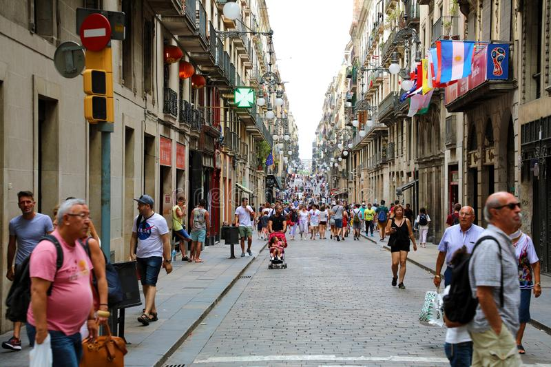 BARCELONA, SPAIN - JULY 13, 2018: tourists strolling the famous. Carrer de Ferran in Barcelona. It is one of the busiest pedestrian areas in Barcelona royalty free stock image