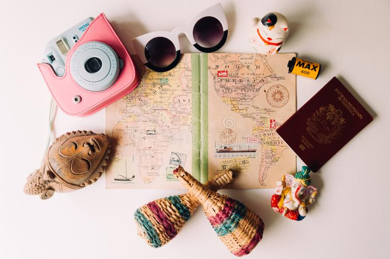 Barcelona, spain - 20 july 2019: travel diary with souvenirs and travel memories on white background with instant camera, camera,. Travel diary with souvenirs stock images