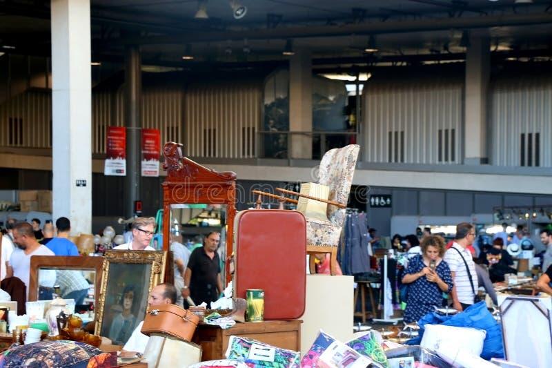 Barcelona, Spain. July 7, 2018: Visitors looking at antiques for sale at Mercat dels Encants, flea market in stock photo