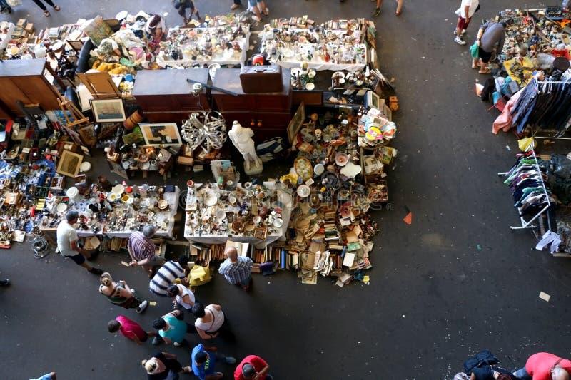 Barcelona, Spain. July 7, 2018: Visitors looking at antiques for sale at Mercat dels Encants, flea market in stock image