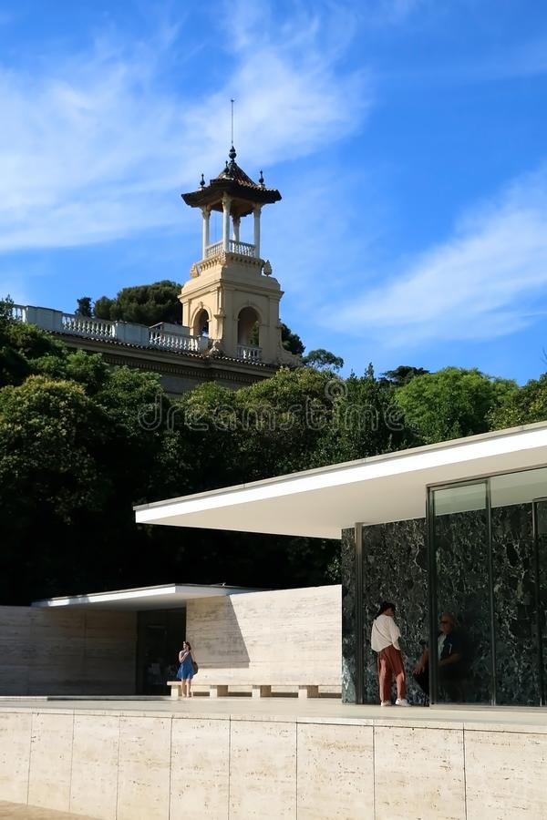 Architecture in Barcelona, Spain. Barcelona, Spain - July 8, 2018: Visitors at Barcelona Pavilion, designed by Ludwig Mies van der Rohe in Barcelona, Spain royalty free stock images