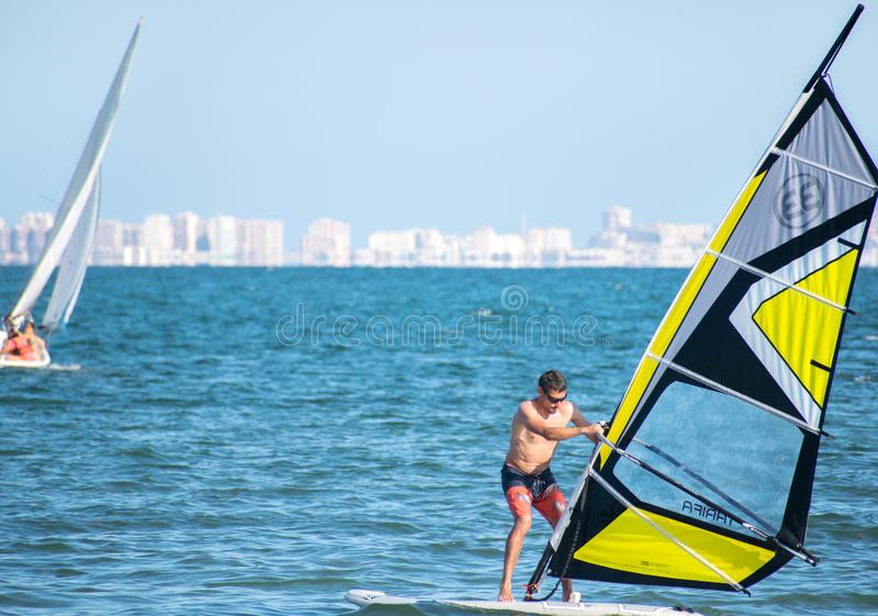 Barcelona, Spain, July 22, 2019: Windsurf Initiation. Man learning to turn the sail royalty free stock photography