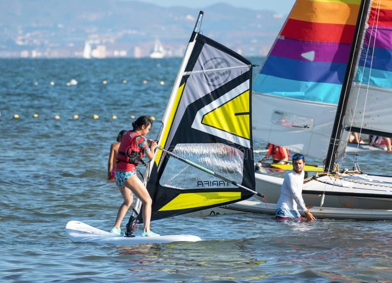 Barcelona, Spain, July 22, 2019: Windsurf Initiation. Man learning to turn the sail. At the sea shore action active beach blue board fun holiday motion nature royalty free stock photography