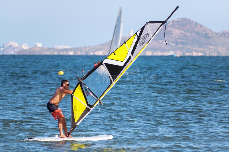Barcelona, Spain, July 22, 2019: Windsurf Initiation. Man learning to turn the sail. At the sea shore action active beach blue board fun holiday motion nature stock photos