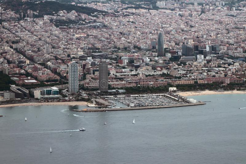 Barcelona, Spain - Jun 09, 2019: Yacht port and city on sea coast, aerial photograph. Yacht port and city on sea coast, aerial photograph. Barcelona, Spain - Jun stock image