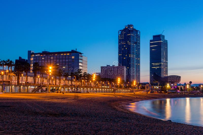 View of buildings on the Beach in Barcelona at sunrise. royalty free stock image