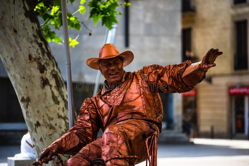 Barcelona, Spain – 2019. Man dressed as cowboy gives live statue performance at famous La Rambla street royalty free stock photos