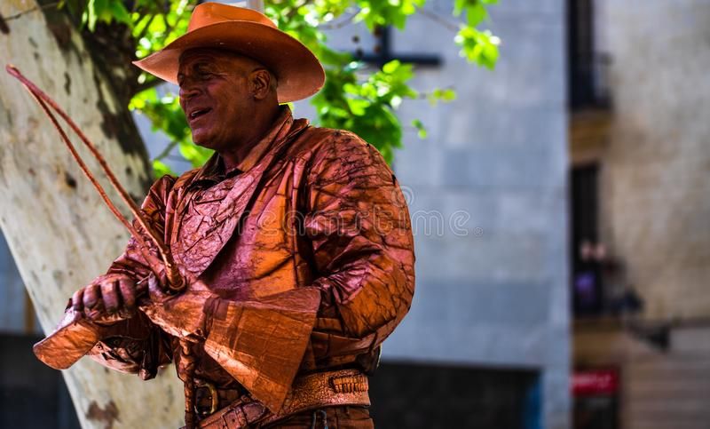 Barcelona, Spain – 2019. Man dressed as cowboy gives live statue performance at famous La Rambla street stock photography