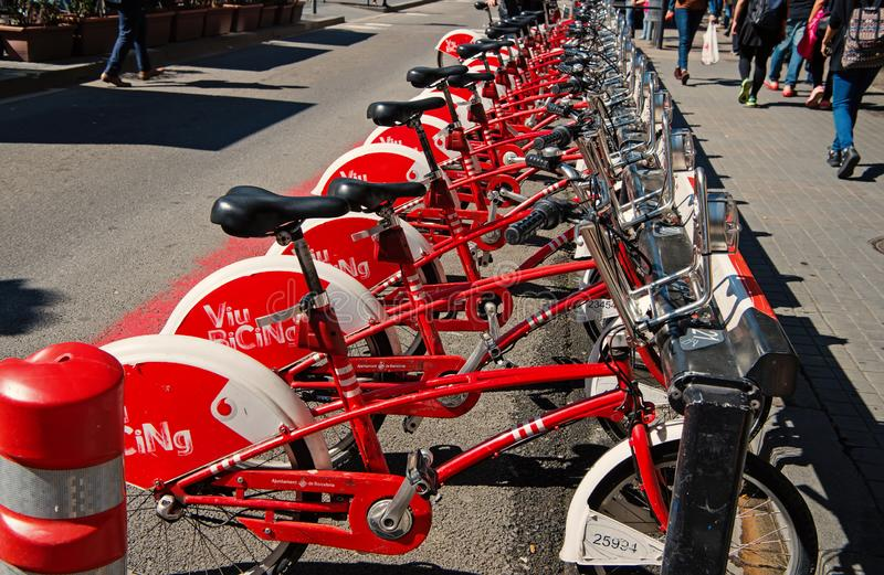 Barcelona, Spain - March 30, 2016: bicycles for rent. Viu Bicing bikes. Public transport of bicycle. City tour and stock photo