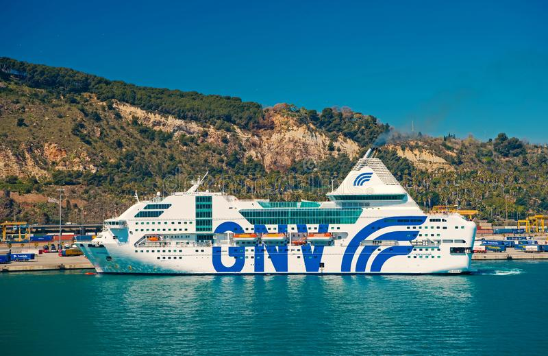 Barcelona, Spain - March 30, 2016: cruise ship GNV Rhapsody Genova in sea on mountain landscape. Cruise destination and royalty free stock photography