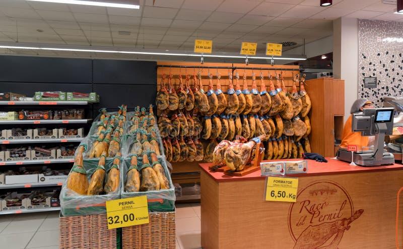 Spanish Serrano ham Jamón in a supermarket, Barcelona, Spain royalty free stock image